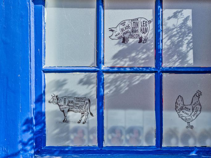 Butcher's window pane with blue paint surrount